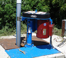 Vertical Pit Pump Drive Sticking Out of Ground